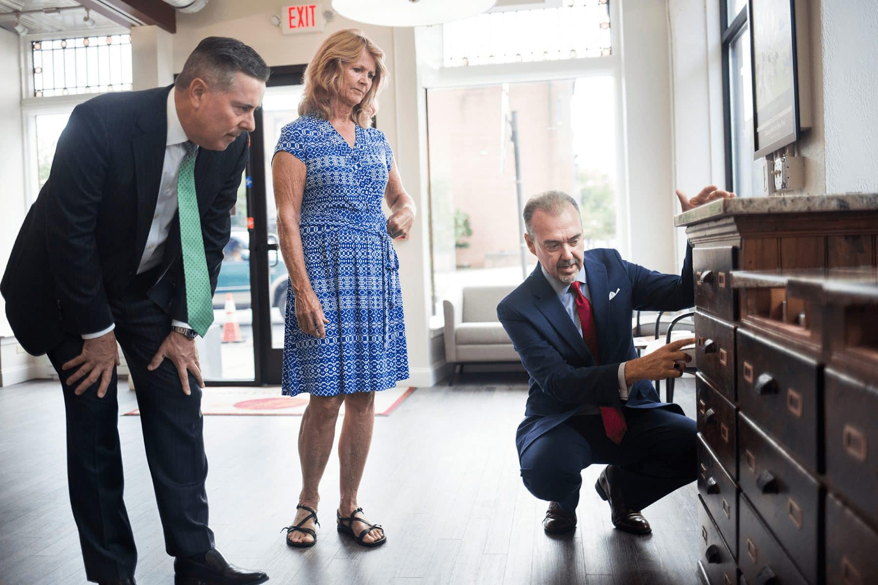"""Annie Haines, granddaughter of Mahlon Haines, York's """"shoe wizard,"""" gets a tour of the new York Traditions Bank branch, where much of the historical integrity of the building was preserved while celebrating its future. (Photo by Paul Chaplin for Our York Media)"""